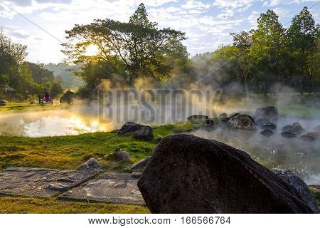 Sunset whit stone and trees in the Park Nation country of Thailand.