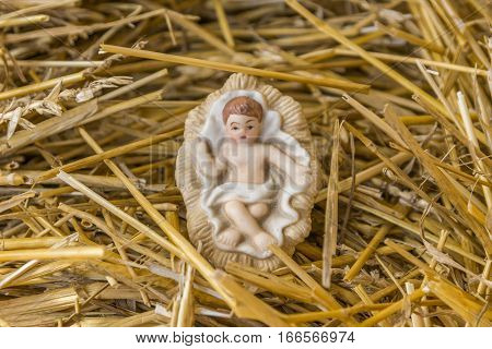 Infant Jesus nativity decoration on a bed of straw