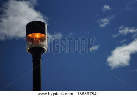Lit lamp post with orange fiery glow