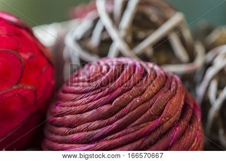 Closeup of textures and beautiful colors of holiday potpourri balls curled like twine red and green