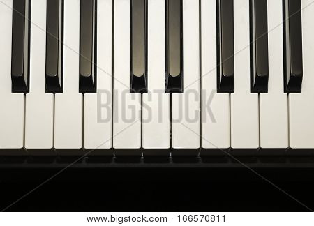 Simple and clean piano keys one octave music closeup space for text on black background