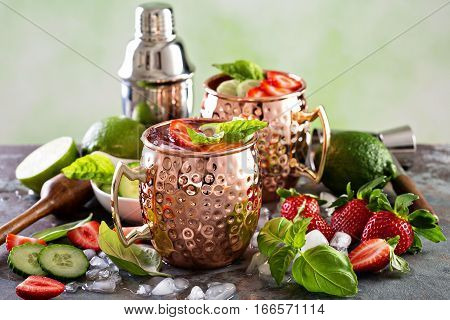Moscow mule cocktail with lime, strawberry and basil