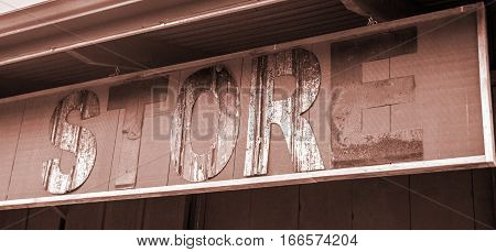 Old vintage rustic store sign hanging letters eroding and rusted