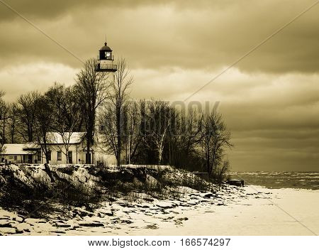 Winter Vintage Lighthouse. Pt. Aux Barques Lighthouse on the remote winter coast of Lake Huron. Port Hope, Michigan.