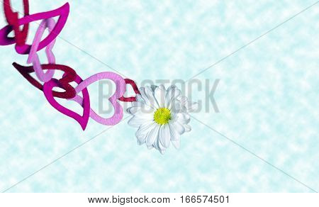 White delicate flower high above the clouds tethered to a chain of hearts concept