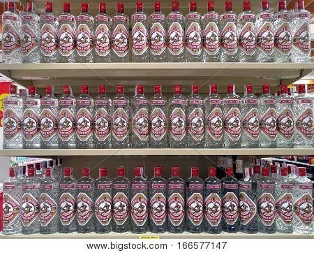 Almeria Spain - December 30 2016: Bottles of Anise vodka in a row. Showcase in the Carrefour supermarket. The most famous anise vodka in Europe produced in Badalona city. Spain
