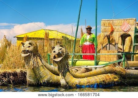 UROS FLOATING ISLANDS PERU - SEPTEMBER 19: Woman on a boat in the Uros Floating Islands Peru on September 19 2014