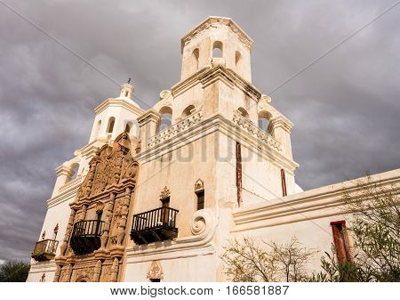 Early mission of San Xavier del Bac known as White Dove in Desert on a cloudy day near Tucson Arizona