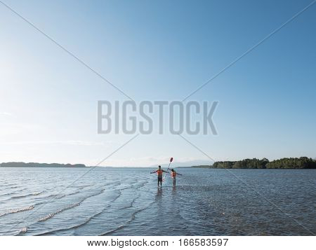 Adventure people wear life jacket stand in the ocean