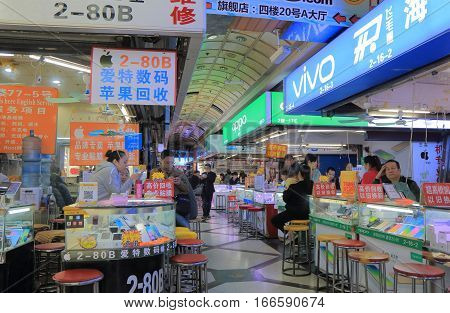 SHANGHAI CHINA - OCTOBER 31, 2016: Unidentified people shop at Bu Ye Cheng Commercial electronics market.