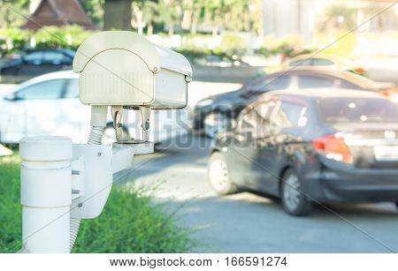 Security equipment concept - CCTV camera surveillance on traffic jam road with flare light effect and copy space