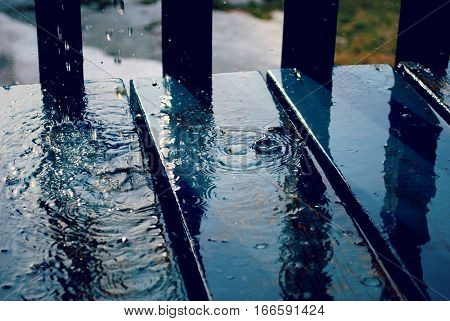 water droplets dripping onto old wood boards