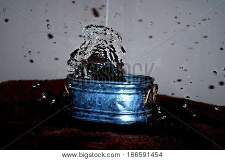 splashing water out of a small tub