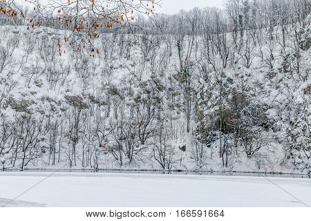 Winter panorama of snowy landscape at Plitvice lakes in Croatia.