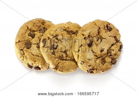 A macro photo of three crunchy chocolate chips cookies, shot from above on a white background