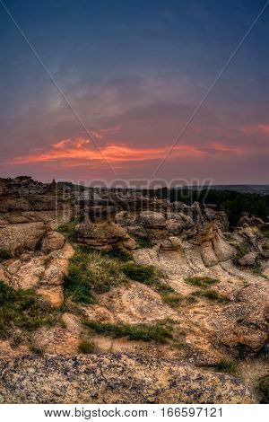 Golden sunrise over the Hoodoo badlands at Writing on Stone Provincial Park and Aisinaipi National Historic Site in Alberta Canada. The area contains a large concentration of First Nation petroglyphs (rock carvings) and pictographs (rock paintings).