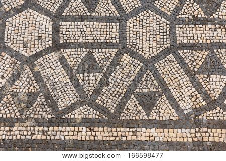 Geometric mosaic of the roman ruins of the ancient city of Conimbriga Beiras region Portugal