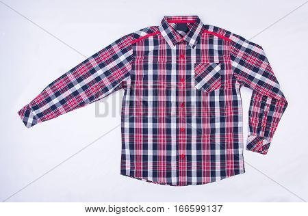 Shirt Or Kids Shirt On A Background.
