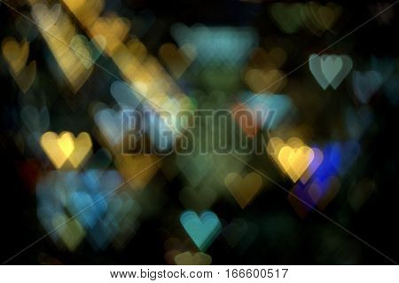 numerous hearts in a multitude of colors on a dark background