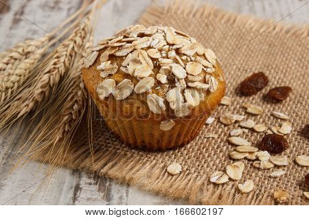 Fresh Muffin With Oatmeal Baked With Wholemeal Flour And Ears Of Rye Grain, Delicious Healthy Desser