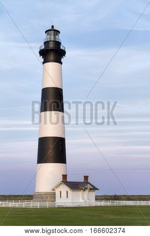 The historic Bodie Island Lighthouse stands tall with white and black stripes at Cape Hatteras National Seashore on the Outer Banks of North Carolina.