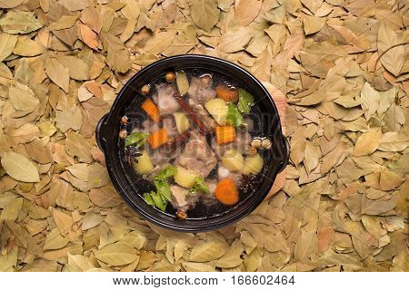 Clear oxtail soup on leaf background, indonesian food.