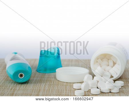 The medicine paracetamol with infrared thermometer background