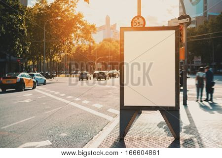 Empty mock up banner for your advertising blank billboard with copy space area for your text message or promotional content public information board in urban setting with highway cars and people
