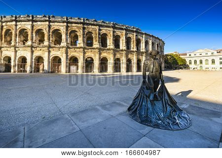 Statue And Arena Of Nimes In France