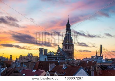 Beautiful view on Old Riga roofs and Saint Peters Church on sunset. Riga, Latvia