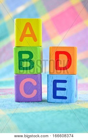 Wooden alphabet blocks toy closeup - ABCDE