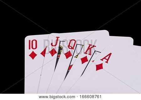 Royal flush. Play cards isolated on black background