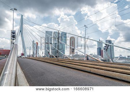 Rotterdam Netherlands - August 6 2016: The 800-metre long Erasmus Bridge spans the Maas River and links the northern and southern parts of Rotterdam.