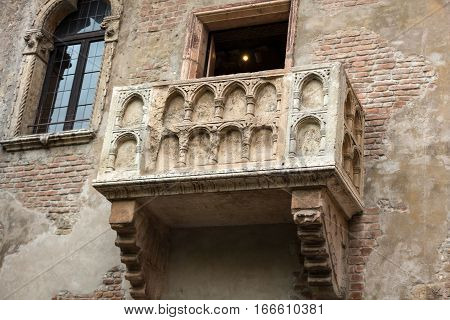 Juliet balcony in Verona. Romeo and Juliet is a tragedy written by William Shakespeare. This place is the main tourist attraction in Verona.