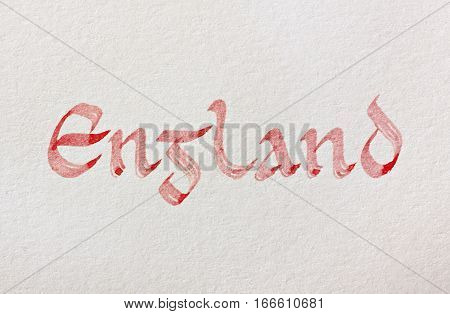 Handwritten country name over white paper background. England. Latin medieval insular script. English language.