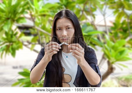 Young Beautiful Woman Holding Broken Cigarette, People Smoke Cigarette Look Like Trying To Commit Su
