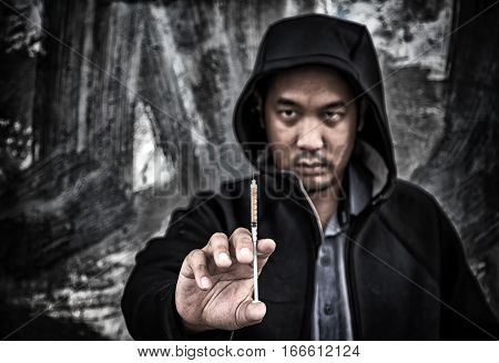 Drug Abuse Concept., Overdose Asian Male Drug Addict Hand With Drugs Narcotic Syringe In Action.