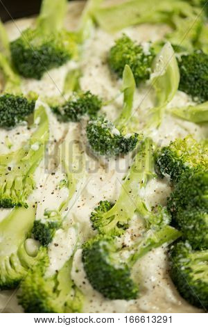 Pastry Dough In Tray Topped With Fresh Broccoli
