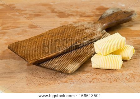Pair Of Butter Paddles Beside Pats Of Butter