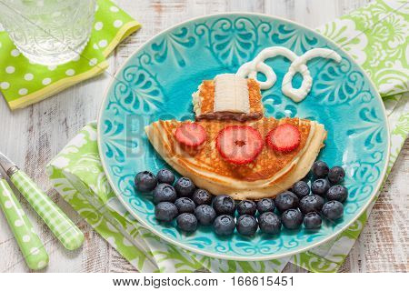 Ship boat pancake with berries for kids breakfast