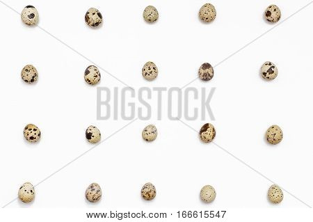 quail eggs on a white background. Easter festive background. Flat lay