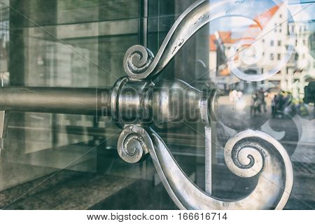 Ancient symbolic key to the city of Riga for the town hall building glass with reflection House of Blackheads in the square