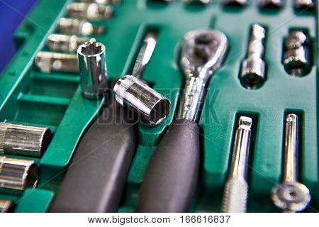 The socket wrenches in plastic box closeup