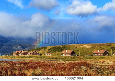 Rainbow over village with mountains in the background Ushuaia Patagonia Argentina