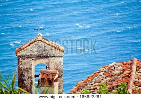 Close up view of the church rooftop in the Eze Sur Mer. Cote de azure. Bright sunny summer day in Europe.