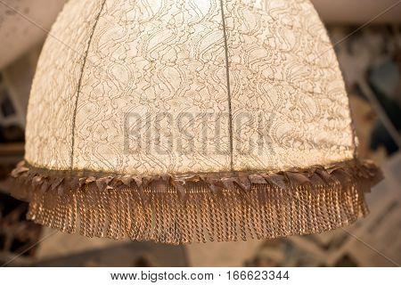 Close-up of elegant vintage retro lampshade in room