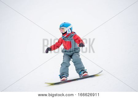 Snowboarder Boy Riding Over The Slope