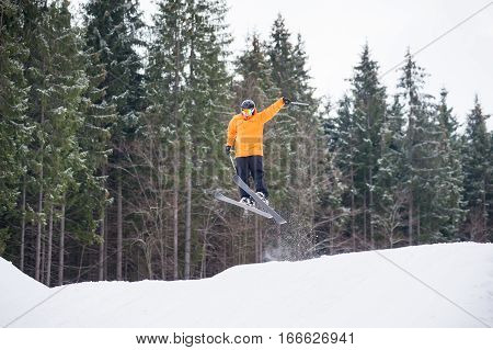 Skier Is Jumping From The Slope Of Mountains