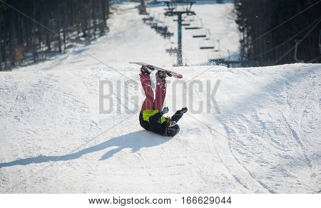 Snowboarder Falls On The Slopes During The Descent