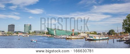 AMSTERDAM, NETHERLANDS - SEPTEMBER 18, 2016: Panorama of the Nemo Science Center in Amsterdam, The Netherlands
